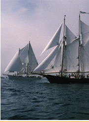 Thomas E. Lannon under sail (right) built by Harold A. Burnham