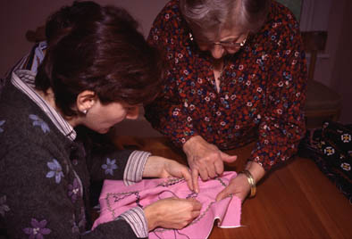 Nairi Havan learning Marash embroidery from Anahid Kazazian, Armenian Marash embroidery, 2002; Lexington, Massachusetts;
