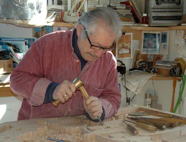 Dimitrios Klitsas carving at his bench, Ornamental woodcarving apprenticeship, 2014; Hampden, Massachusetts; Photography by Maggie Holtzberg