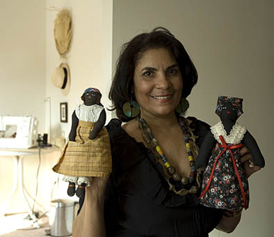 Posing with two of her black dolls, Dollmaking, 2009; Ivelisse Pabon de Landron (b. 1952); Ashland, Massachusetts; Photography by Maggie Holtzberg