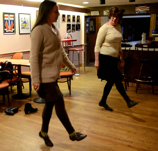 Mary MacGillivray and Jennifer Schoonover stepdancing at the Canadian American Club, Cape Breton stepdance, 2016; Belmont, Massachusetts;