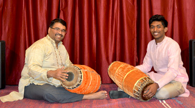Mahalingam Santhanakrishnan playing mridangam, Carnatic mridangam, 2018; Lexington, Massachusetts; Photography by Maggie Holtzberg