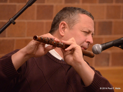 Jimmy Noonan performing at Boston College, 2014. Photo credit Paul Wells, Irish flute and penny whistle player, 2014; James Noonan; Holbrook, Massachusetts;