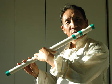 Penpa Tsering playing the tyling, Tibetan musician, 2014; Penpa Tsering (b. 1963); Bedford, Massachusetts; Photography by Maggie Holtzberg