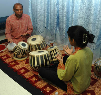 Chris Pereji playing tabla drums., North Indian tabla, 2009; South Attleboro, Massachusetts; Photography by Maggie Holtzberg