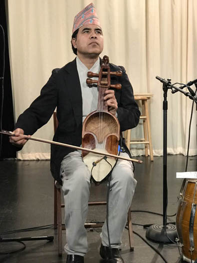Shyam Nepali playing the sarangi, Nepalese Music, 2018; Watertown, MA; Photography by Maggie Holtzberg