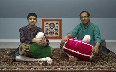 Apprentice Ullas Rao with Pravin Sitaram, South Indian mridangam, 2009; Westwood, Massachusetts; Photography by Maggie Holtzberg