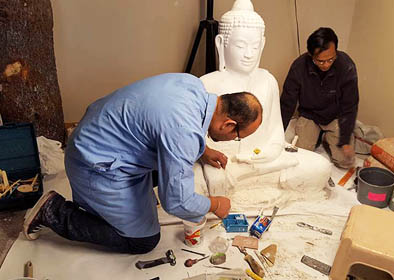 Yary Livan and Panit Mai working on Buddha sculpture, Cambodian ornaments, 2016; Lowell, Massachusetts;