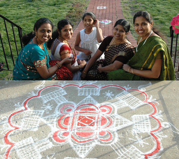 Members of Tamil Takkal Mandram with kolam by Priya Govindarajam, Kolam art, 2016; Tamil Takkal Mandram, Inc.; Newton, Massachusetts; Photography by Maggie Holtzberg