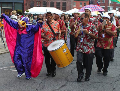 Performing as masquerader in the parade at Lowell Folk Festival; musician; 2012: Lowell, Massachusetts