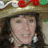 Robyn Clayton posing in her kitchen; St. Peter's Fiesta Hats; 2012: Gloucester, Massachusetts