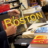 Josh Luke holding a Boston style sign painting; Sign painting; 2015: Dorchester, Massachusetts; Reverse glass gilding; 12 x 24 inches
