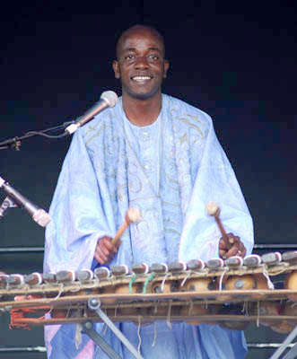 Balla Kouyaté performing. Photography by Alison Williams; Malian musician; 207: