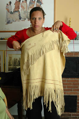 Michelle Fernandes holding up shawl with fringe. Photography by Russel Call; Apprenticeship - Native regalia; 2006: West Barnstable, Massachusetts