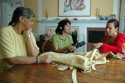 Anita Peters Little and Michelle Fernandes being interviewed by Maggie Holtzberg. Photography by Russell Call; Apprenticeship - Native regalia; 2006: West Barnstable, Massachusetts