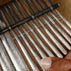 Solomon Murungo playing the mbira. Photograpy by Jeff Crandall; Musician; 2008: Bolton, Massachusetts