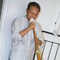 Penpa Tsering playing the Tibetan rag-dung (trumpet); Tibetan musician; 2014: Bedford, Massachusetts