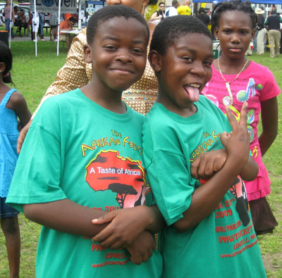 Young boys in African Festival t-shirts; Ethnic festival; 2009: Lowell, Massachusetts